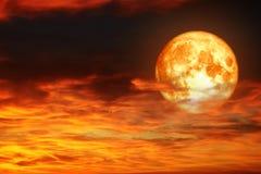 Super full blood moon back sunset hot red orange cloud Royalty Free Stock Images