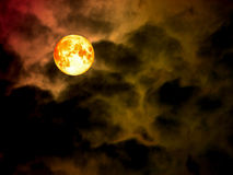 super full blood moon in the night sky Stock Photos