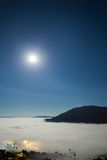 Super full moon and fog in the morning with mountain at Khao Kho Stock Image