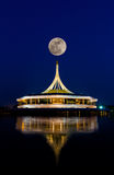 Super full moon over a beautiful building Stock Photos