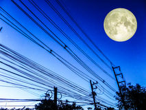 Super full moon and power elecrtic line Stock Image