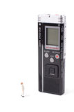 Super gadget. Tiny man and huge voice recorder isolated stock photography