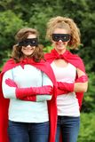 Super girl. Super team of super heros girl with red cape and red gloves royalty free stock image