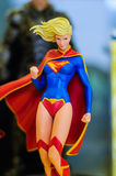 Super Girl Figurine. Realistic figurine of Super Girl comic character on a sophisticated toy and collection shop stock photography