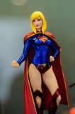 Super Girl Figurine. Realistic figurine of Super Girl comic character on a sophisticated toy and collection shop Stock Photos