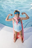 Super girl protecting the pool Stock Images