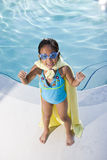 Super girl protecting the pool Royalty Free Stock Photo