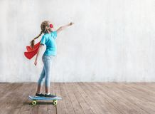 Super girl skating on a skateboard royalty free stock image