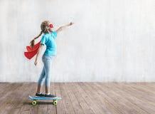 Super girl skating on a skateboard. In studio royalty free stock image