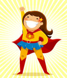 Super girl. Girl in a superhero costume standing in a heroic position Royalty Free Stock Photos