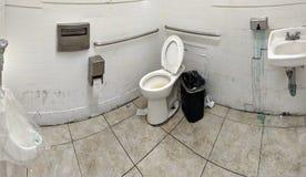 Super gross bathroom in LA. Super gross gas station one person bathroom in LA royalty free stock photos