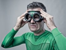 Super héroe con mún dolor de cabeza Imagen de archivo libre de regalías