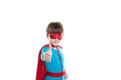 Super héroe joven del muchacho dándole los pulgares para arriba Imagenes de archivo