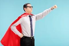 Super héroe orgulloso con el puño agarrado Imágenes de archivo libres de regalías