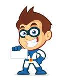 Super héroe que sostiene una tarjeta de visita en blanco Imagen de archivo libre de regalías