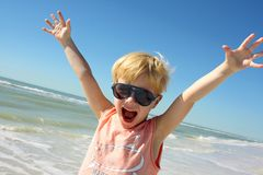 Super Happy Boy on Beach by Ocean Stock Image