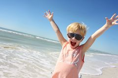 Super Happy Little Boy on Beach Stock Images