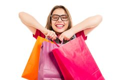 Super happy woman with colorful shopping bags royalty free stock images