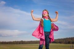 Super-herói do poder da menina Fotografia de Stock Royalty Free