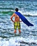 Super-herói na praia Fotografia de Stock Royalty Free