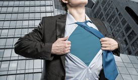 Super hero. Businessman tearing his shirt under her blue clothes super hero Stock Photography