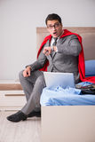 The super hero businesswoman working in bed Stock Image