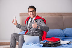 The super hero businesswoman working in bed Stock Photography