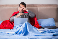 The super hero businesswoman working in bed Stock Photos