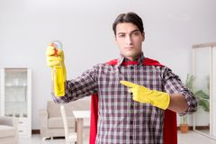 The the super hero cleaner doing housework. The super hero cleaner doing housework Royalty Free Stock Image