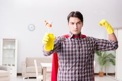 The the super hero cleaner doing housework. The super hero cleaner doing housework Royalty Free Stock Photography