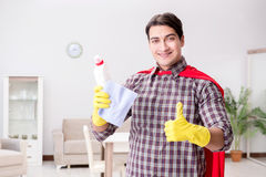 The the super hero cleaner doing housework. The super hero cleaner doing housework Stock Image