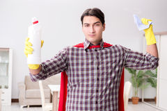 The the super hero cleaner doing housework. The super hero cleaner doing housework Stock Photo