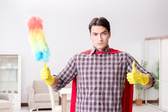 The the super hero cleaner doing housework. The super hero cleaner doing housework Stock Photos