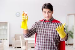 The the super hero cleaner doing housework. The super hero cleaner doing housework Royalty Free Stock Images