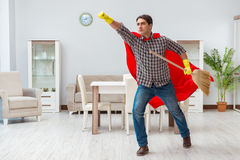 The super hero cleaner working at home Stock Images