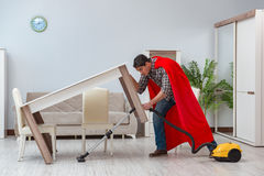 The super hero cleaner working at home Royalty Free Stock Photo