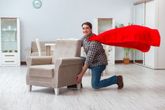 The super hero cleaner working at home Stock Photography