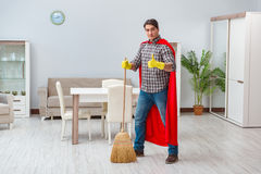 The super hero cleaner working at home Stock Photos