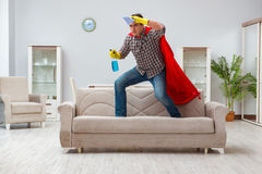 The super hero cleaner working at home Stock Image