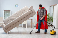 The super hero cleaner working at home. Super hero cleaner working at home Royalty Free Stock Image