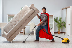 The super hero cleaner working at home. Super hero cleaner working at home Stock Photography