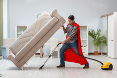 The super hero cleaner working at home. Super hero cleaner working at home Royalty Free Stock Photo