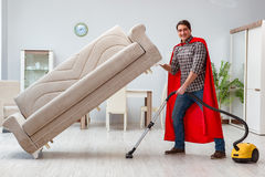 The super hero cleaner working at home. Super hero cleaner working at home Royalty Free Stock Photos