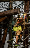 Super Hero Competitor 2014 Tough Guy Obstacle Race In Fancy Dress Hanging On Ropes Royalty Free Stock Images