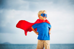Super Hero flying in he sea. Super Hero Kid smiling with a goggles in the eye stock images