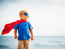 Super Hero flying in he sea Royalty Free Stock Image