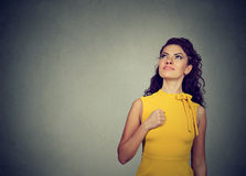 Super hero girl. Confident young woman. Isolated on gray wall background royalty free stock images