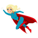 Super Hero Girl Flying. Blonde super hero girl flying fast in blue and red costume with cape Royalty Free Stock Image