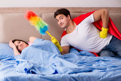 The super hero husband in bed Royalty Free Stock Images