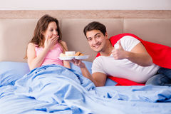 The super hero husband in bed. Super hero husband in bed stock image